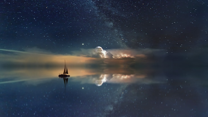 Sailing ship superimposed on a star field